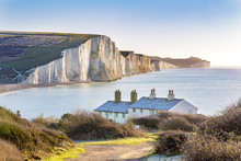 The Coast Guard Cottages And Seven Sisters Chalk Cliffs Just Outside Eastbourne, Sussex, England, UK.