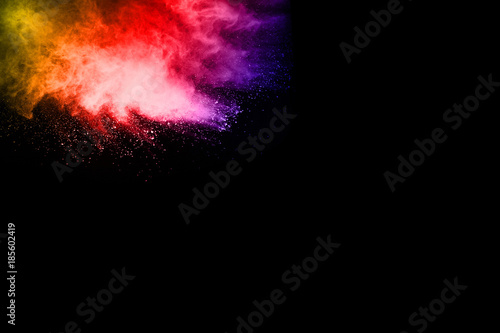 Photo sur Toile Les Textures abstract powder splatted background. Colorful powder explosion on black background. Colored cloud. Colorful dust explode. Paint Holi.