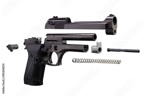 Photo Disassembled pistol weapon. Isolated on white background