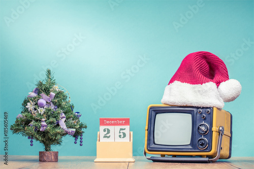 Retro Tv In Santa S Hat Tree And Wooden Desk Calendar With The 25 Of