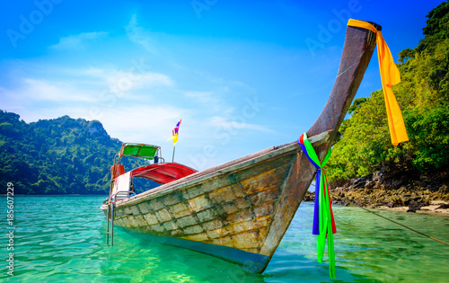 Concept of travel and relax. Beautiful local fishing boats on sea blue Railay beach, Krabi Thailand