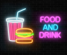 Neon Food And Drink Glowing Signboard On A Dark Brick Wall Background. Burger And Plastic Cup Of Beverage Signs.