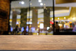 Empty wood table top and blur of night market background/selective focus .For montage product display.