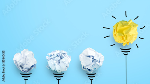 Obraz Creative idea, Inspiration, New idea and Innovation concept with Crumpled Paper light bulb on blue background. - fototapety do salonu