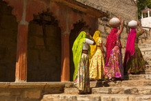 Women Carry Ceramic Pot In Step Well