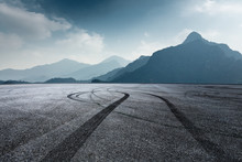 International Circuit Asphalt Ground And Mountain Nature Landscape In Foggy Day