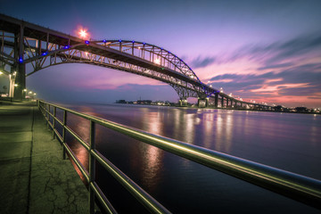 Blue Water Bridge Cityscape Panorama. The waterfront district of Port Huron, Michigan with the Blue Water Bridge. The Bridge connects the USA and Canada.