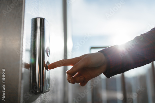 The thumb presses the Elevator button, a hand reaching for the button, the girl Wallpaper Mural