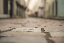Low Angle Closeup Background Of Old Pavement With Blurred Background