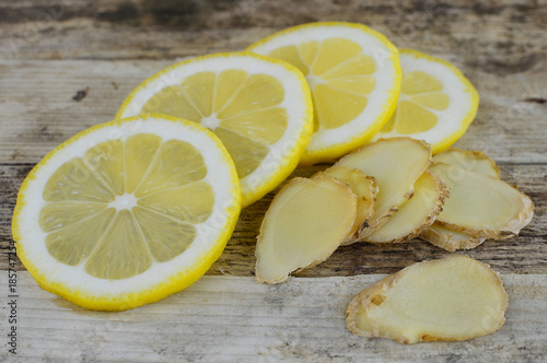 Photo  Closeup image of ingredients for natural cold or flu remedy includes ginger and lemon on a wooden background