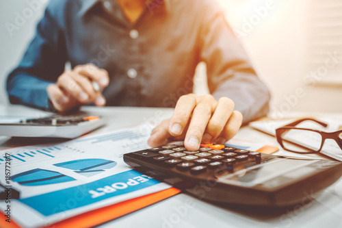 Fototapeta Young business man inspector in financial report. obraz