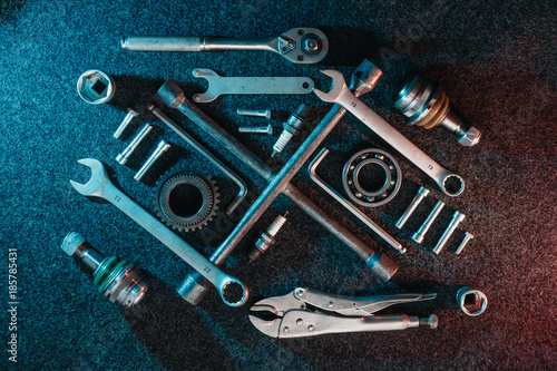 Photo Bearings, wrenches, bolts on a dark background
