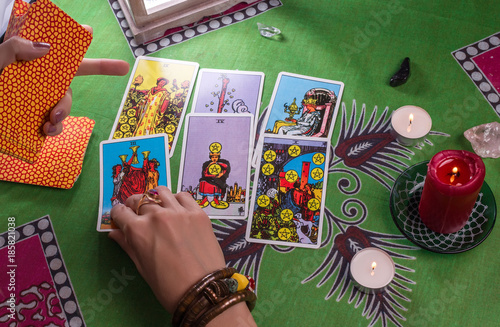 Photo  Divination by tarot cards.