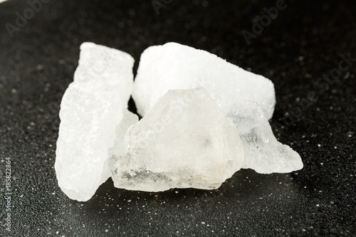 Crystallized alum chunks isolated on a black background Canvas Print