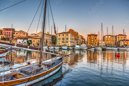 Boats in La Maddalena harbor at sunset