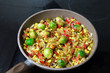 Brussels sprouts roasted with pepper and onions
