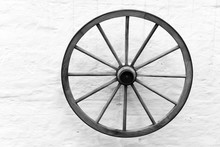 Old Wooden Cart Wheel On The W...