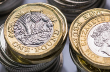 Close Up Focus Photos Of New United Kingdom Pound Coin, Among Other British Coins