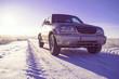 SUV on winter horizon.
