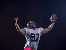 American Football Player Celebrating After Scoring A Touchdown