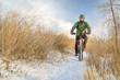 senior cyclist is riding a fat bike