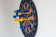 Closeup Of Arrow In Magnetic Darts Game