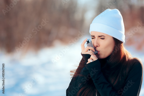 Photo Woman with Inhaler Suffering Asthma Attack in Winter