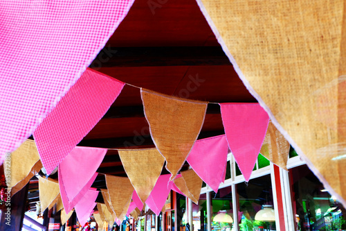 Fototapety, obrazy: New Year is Pennant. Pink and Orange Party Flags Made of Paper On the Rope Background Great for Any Use.