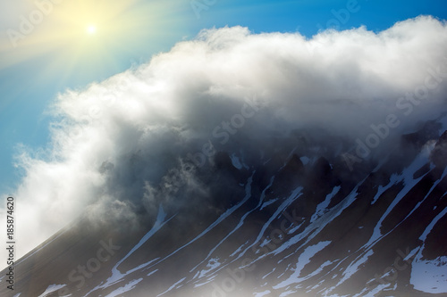 Poster Poolcirkel Cloud caught on the glacial sheet, nunatak in fog