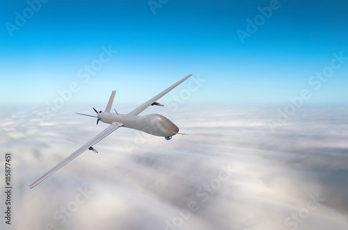 Unmanned military aircraft fly high speed background blue sky clouds плакат