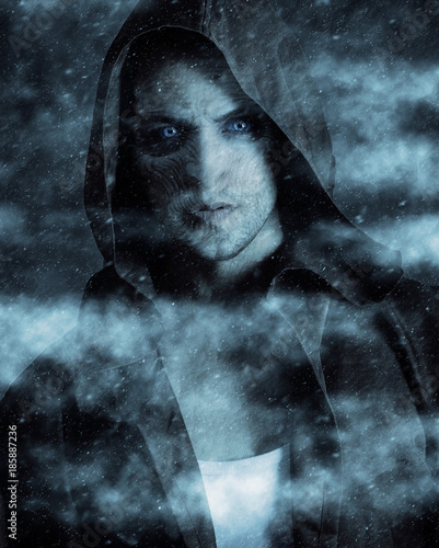 snow demon wearing a hood. Fantasy character Canvas Print