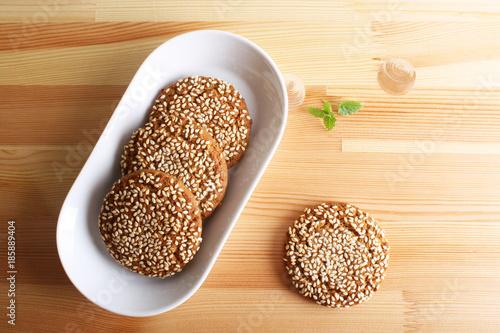 Fototapeta oatmeal cookies with sesame seeds obraz