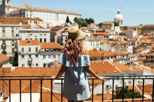 Obraz na płótnie Young woman looking at Lisbon city panorama of Alfama on trip