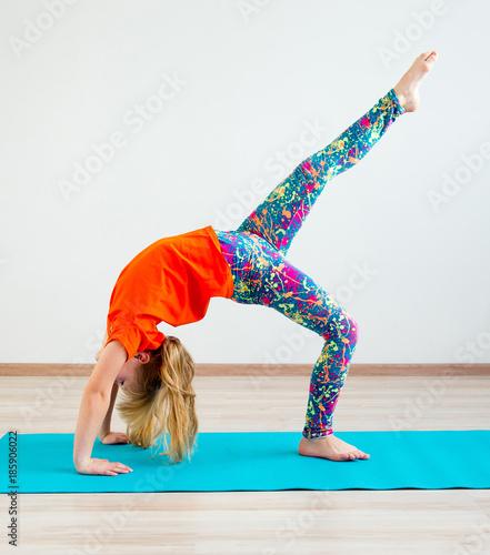 Foto auf Leinwand Gymnastik Girl doing exercises