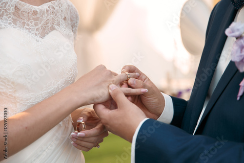 Fototapety, obrazy: Couple holding hands during wedding ceremony