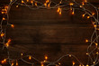 Christmas garland lights on brown wooden table