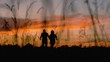 Silhouette of running couple. Man and woman run hand in hand approaching and jumping up on a sunset sky background. Concept of inspiration.