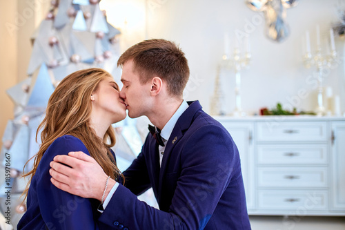 A Guy With A Girl Is Celebrating Christmas A Loving Couple Enjoy