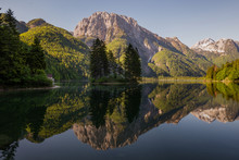 Reflections In Lago Del Predil In The Morning In Tarvisio Municipality In Italy