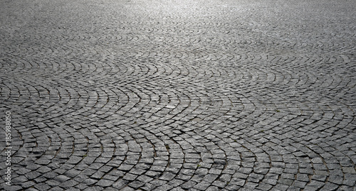 Old cobblestone pavement close-up.
