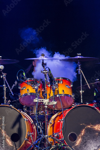Drummer at a concert in a cloudy smoke.