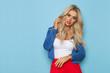 Leinwanddruck Bild - Sexy Blond Woman In In Blue Unbuttoned Jacket