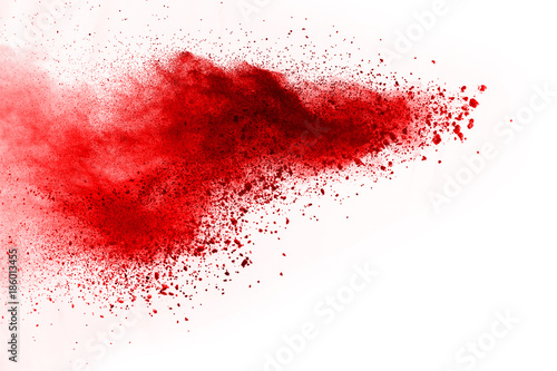 abstract powder splatted background. Red powder explosion on black background. Colored cloud. Colorful dust explode. Paint Holi.