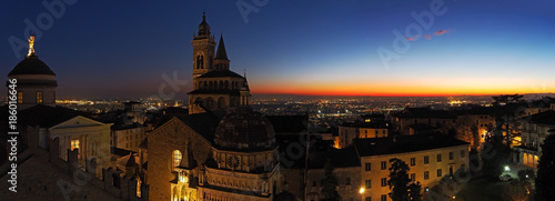 Fotobehang Milan Bergamo, Italy. The old city. Aerial view of the Basilica of Santa Maria Maggiore and the chapel Colleoni during the sunset. In the background the Po plain