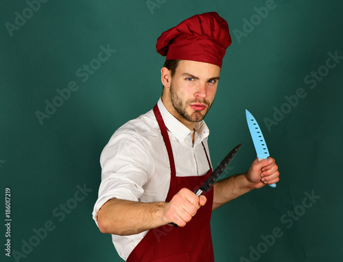 Photo  Kitchenware and cooking concept. Cook works in kitchen.
