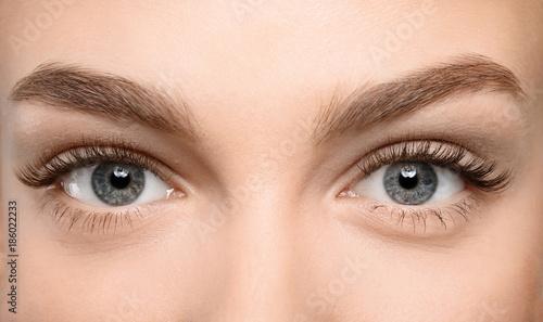 Beautiful female eyes with long eyelashes, closeup