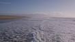 Aerial Drone Footage Of Ocean Waves Breaking On Shore