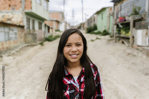 Portrait of beautiful girl in shanty town. Canvas Print