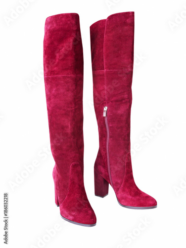 Red suede trendy jack boots isolated. Female shoes pair.
