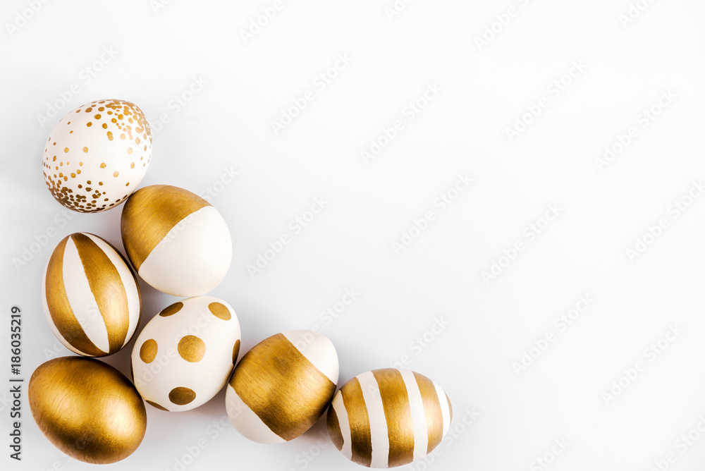 Photo  Top view of easter eggs colored with golden paint